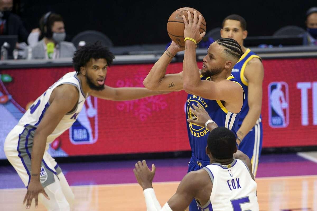 Golden State Warriors guard Stephen Curry (30) shoots a 3-pointer against the Sacramento Kings during the first quarter of a preseason NBA basketball game in Sacramento, Calif., Tuesday, Dec. 15, 2020. (AP Photo/Randall Benton)