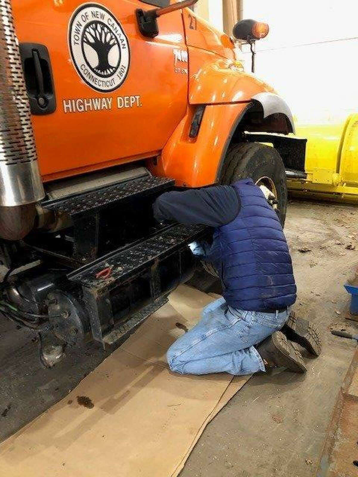 Neal Coppolla prepares a New Canaan Public Works truck to respond to a Noreaster expected to dump heavy snow on New Canaan and the region Wednesday into Thursday.