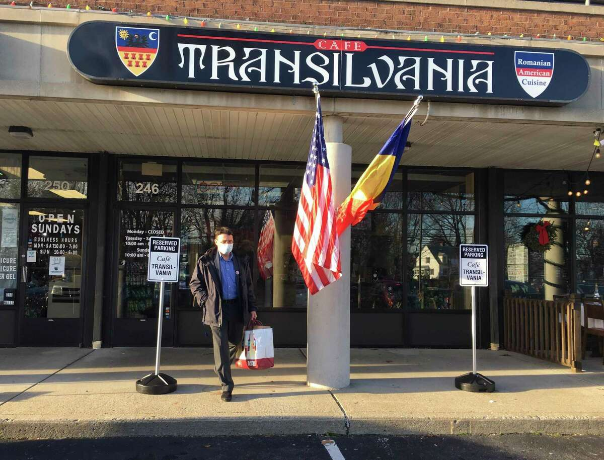 Cafe Transilvania opened in Fairfield Tuesday, Dec. 15, 2020, by owners Alina and Christian Caldarariu. Alina's mother, Ioana Duma, is also pictured in the kitchen.