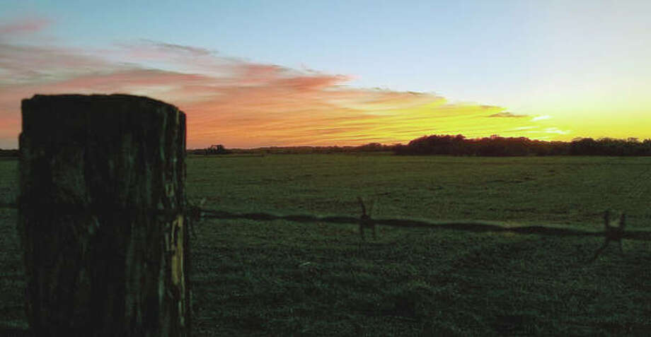 A barbed wire fence seems to corral the setting sun near Jacksonville.