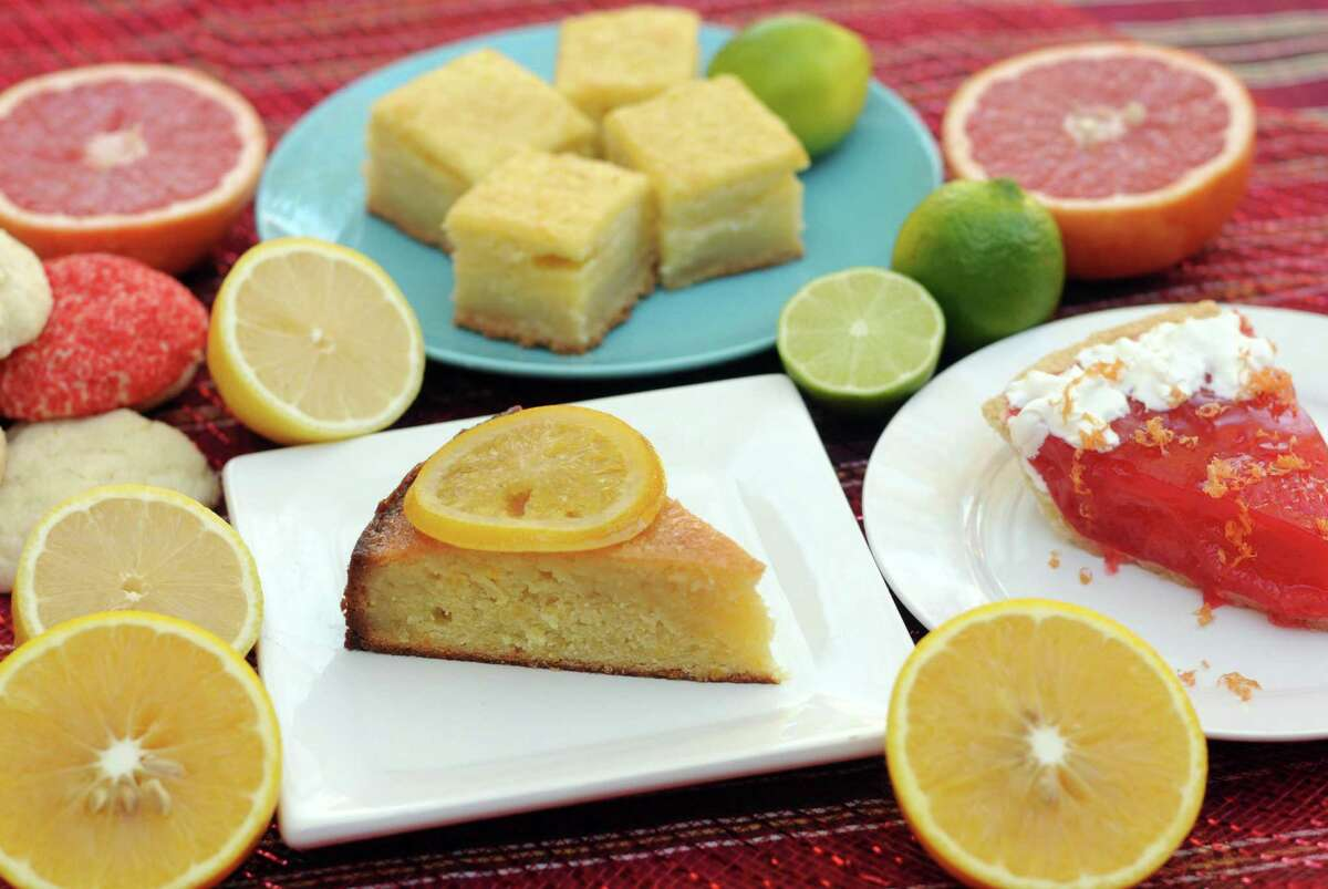We're celebrating Texas' citrus season in four desserts. Clockwise from bottom: Orange Syrup Cake with Candied Oranges, Lemon Sugar Cookies, Leftover Citrus Bars and Rio Star Grapefruit Pie.