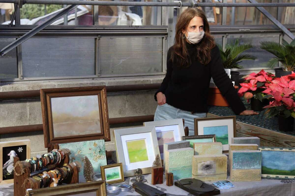 Bonnee Pacquex, of Wilton-based Florabundance, minds her table of artwork at the Westport Farmer's Market on Tuesday, Dec. 15, 2020.