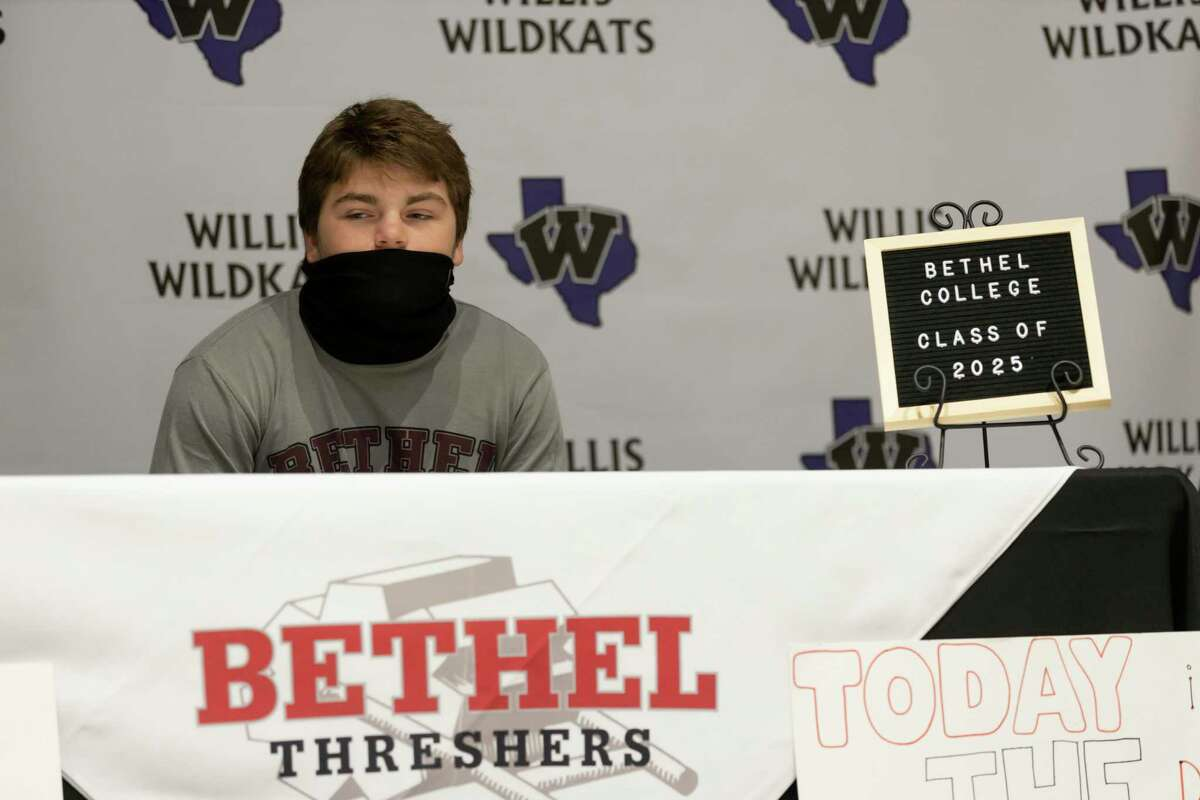 Jace Halbaedier, who signed with Bethel College's football team, looks at his family during a National Signing Day ceremony at Willis High School, Wednesday, Dec. 16, 2020, in Willis.