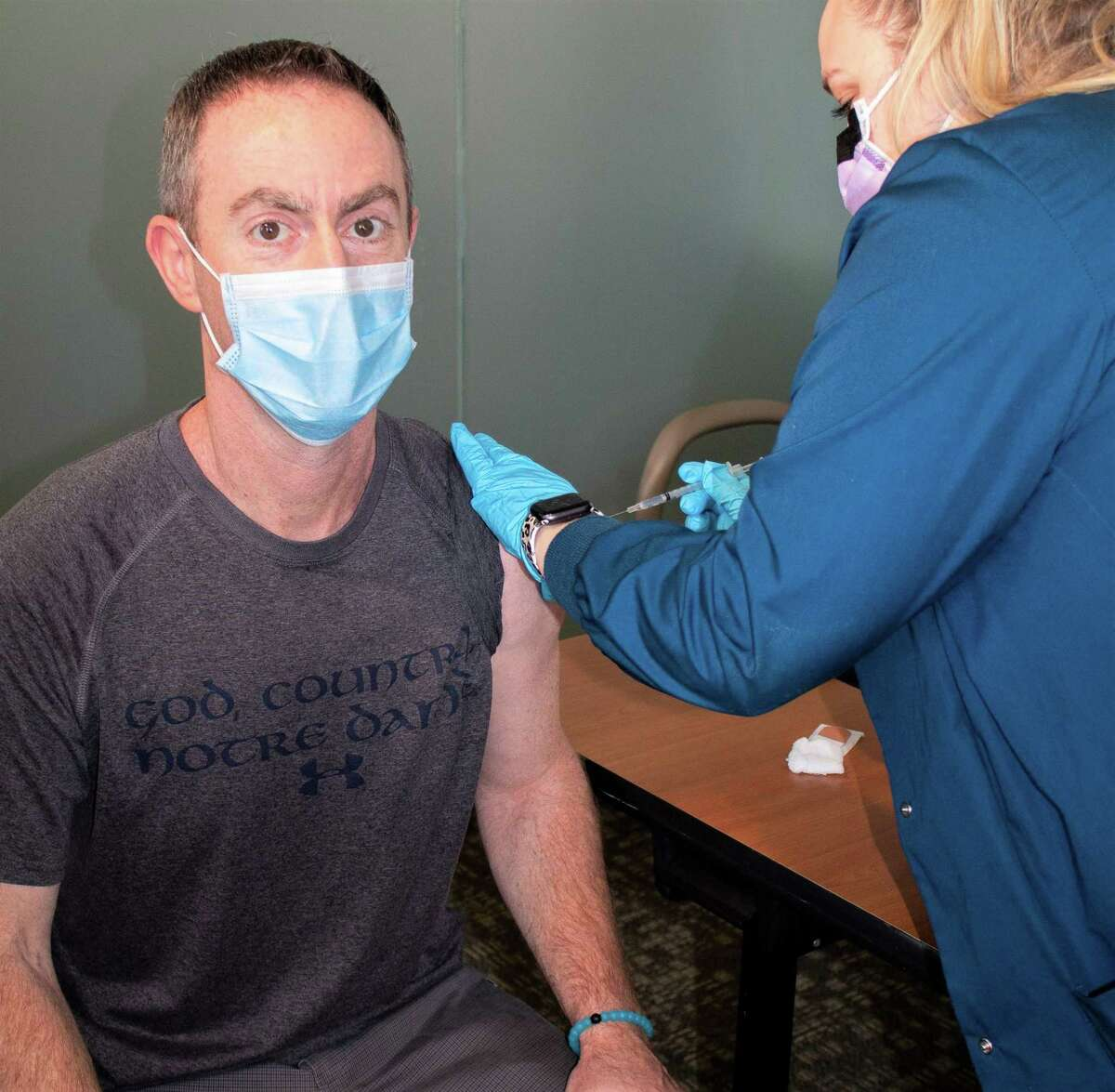 The first 12 Middlesex Health employees received the Pfizer-BioNTech COVID-19 vaccine Tuesday. Shown is Dr. Jon Bankoff, Middlesex Health chairman of emergency medicine.