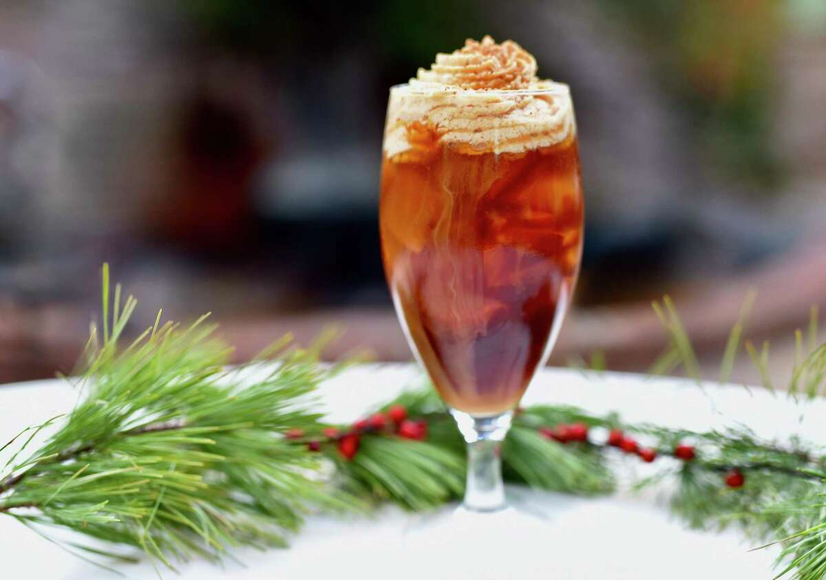 Holiday Hoodoo is a Christmas cocktail made with cold brew coffee, hazelnut and walnut liqueurs and whipped cream flavored with chicory liqueur from Brennan's of Houston.
