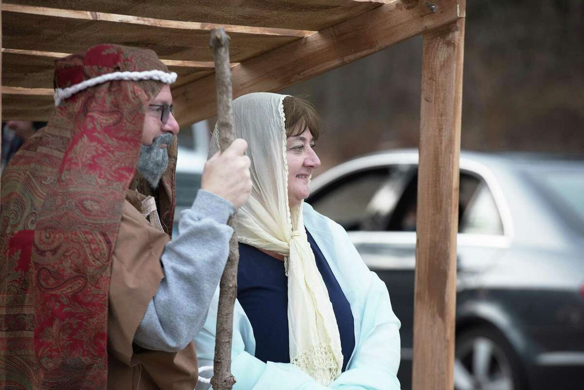 Mary and Joseph greet visitors to the drive-by living nativity presented Sunday by Wilton Presbyterian and St. Matthew's Episcopal churches.