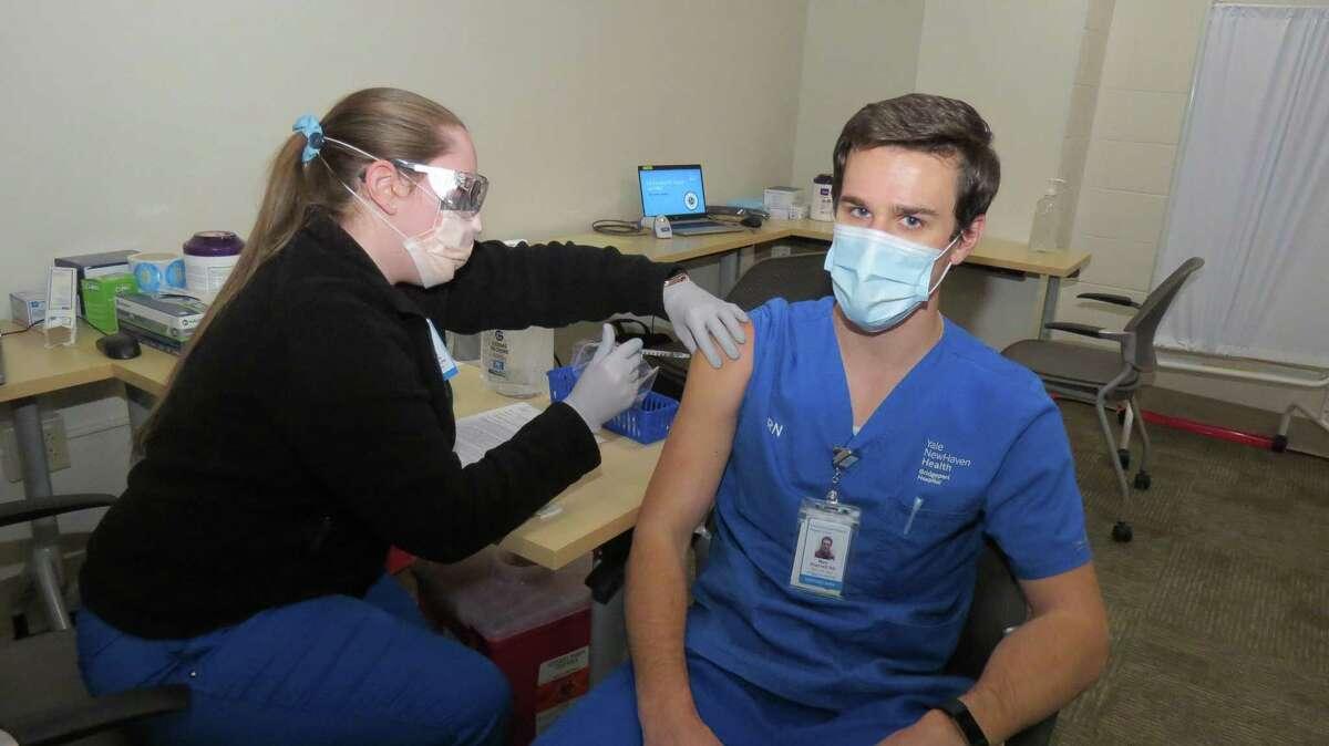 Marc Shackett, RN, Bridgeport Hospital Critical Care Resource Support Unit, received his COVID-19 vaccine at Bridgeport Hospital Dec. 16, 2020.