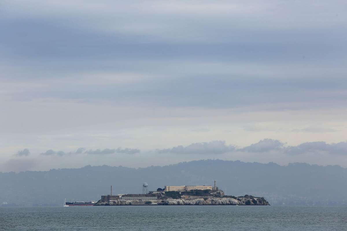 Alcatraz Island is seen below clouds in the sky on Friday, December 11, 2020 in San Francisco, Calif. Rain is expected in the Bay Area on Friday afternoon.