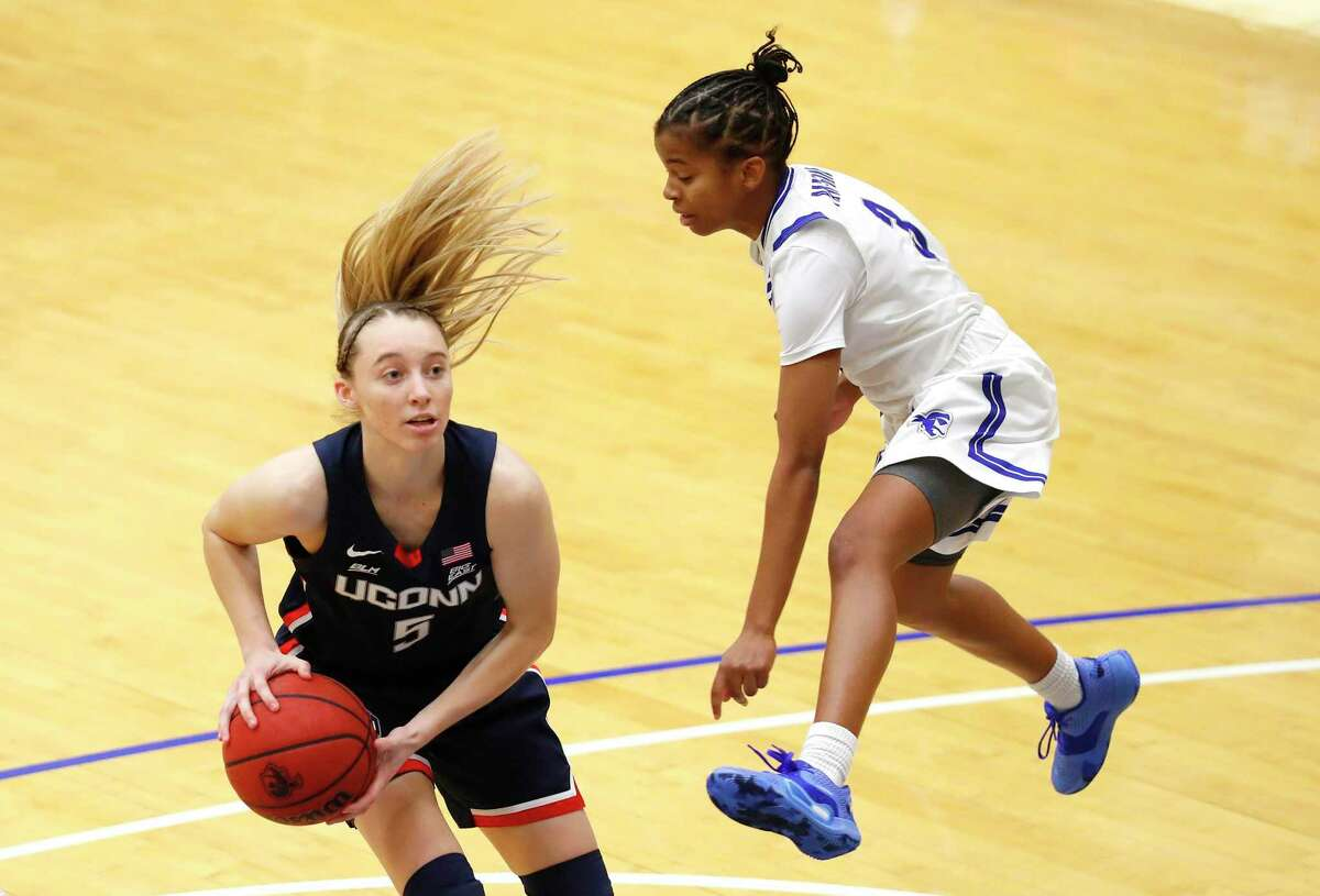 Seton Hall guard Lauren Park-Lane (3) defends against UConn guard Paige Bueckers (5) during the second half of an NCAA basketball game on Tuesday, Dec.15, 2020, in South Orange, N.J. (AP Photo/Noah K. Murray)