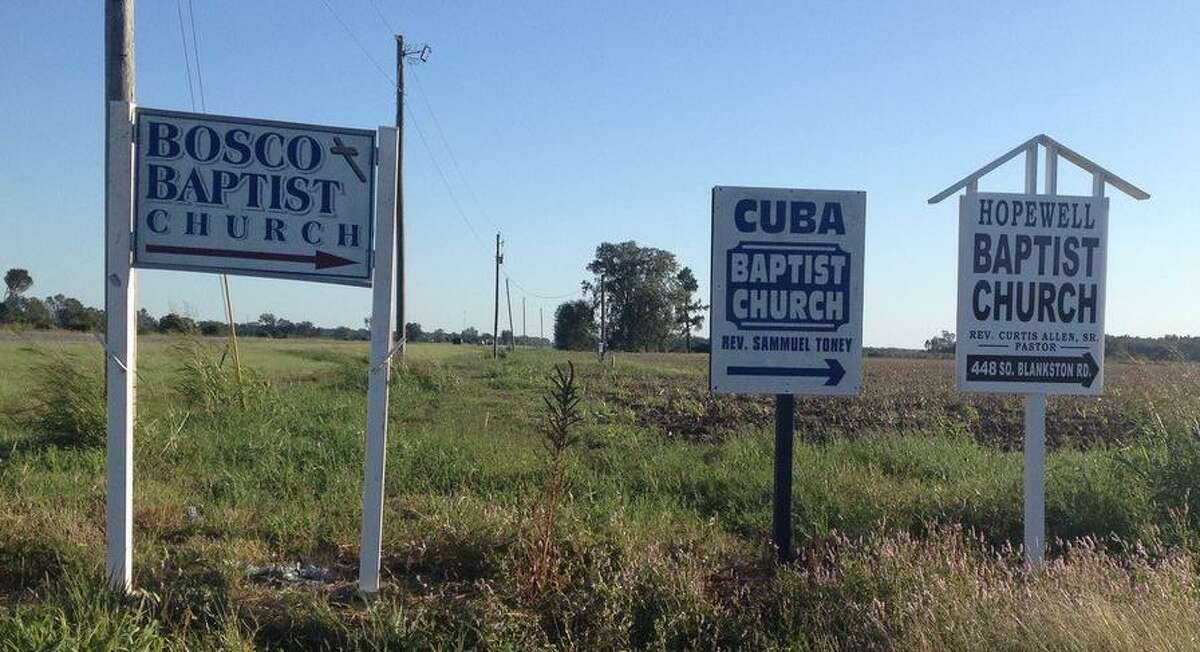 New Milford resident Gerard Monaghan traveled across the country this year serving as a Census enumerator. He visited many states, including Louisiana. Above, road signs point to three Baptist churches on Blankston Road in Monroe, La.