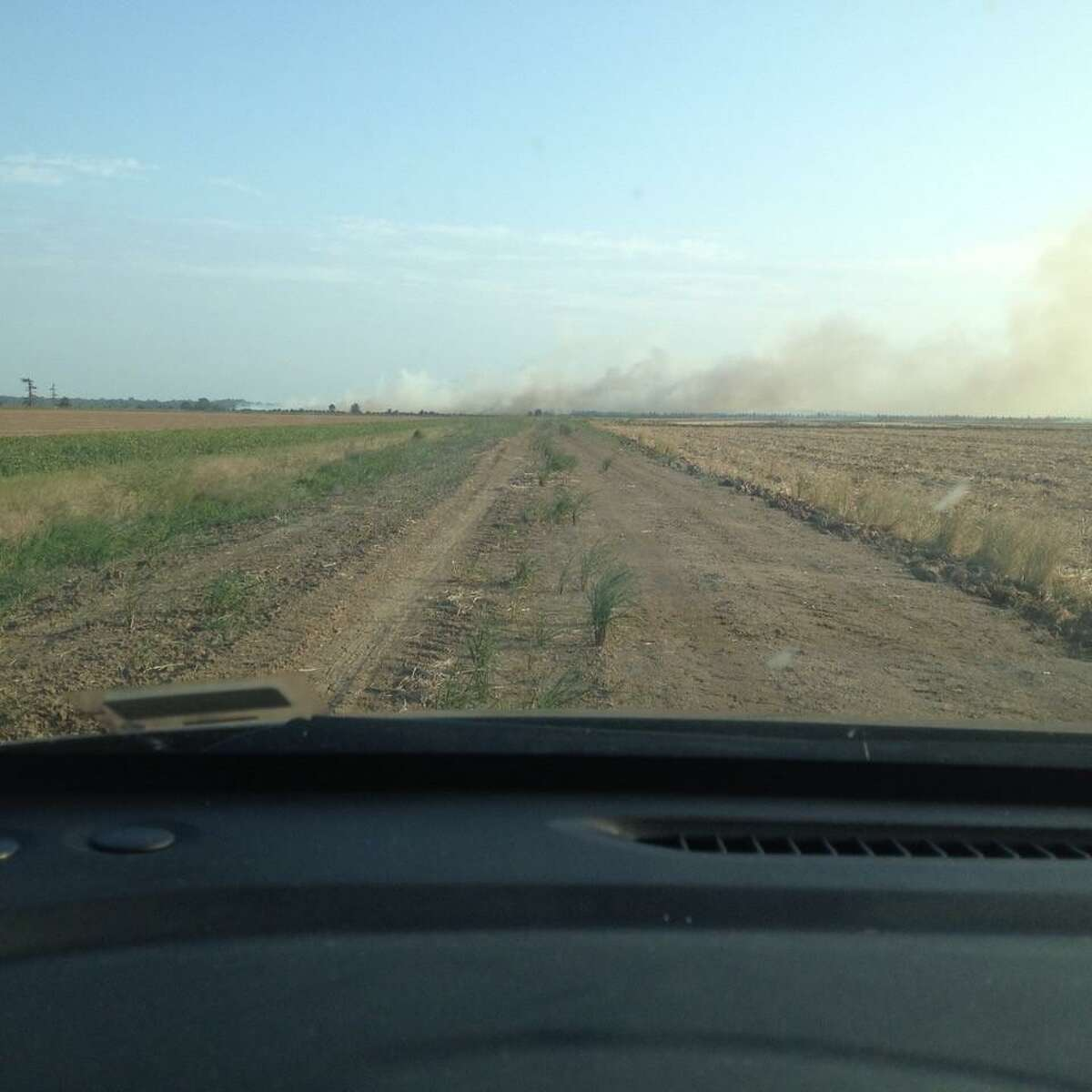 Farmers burn field stubble at the end of a one-lane dirt road near Kilbourne Highway in Jones, La., which New Milford resident Gerard Monaghan visited this year as a Census enumerator.
