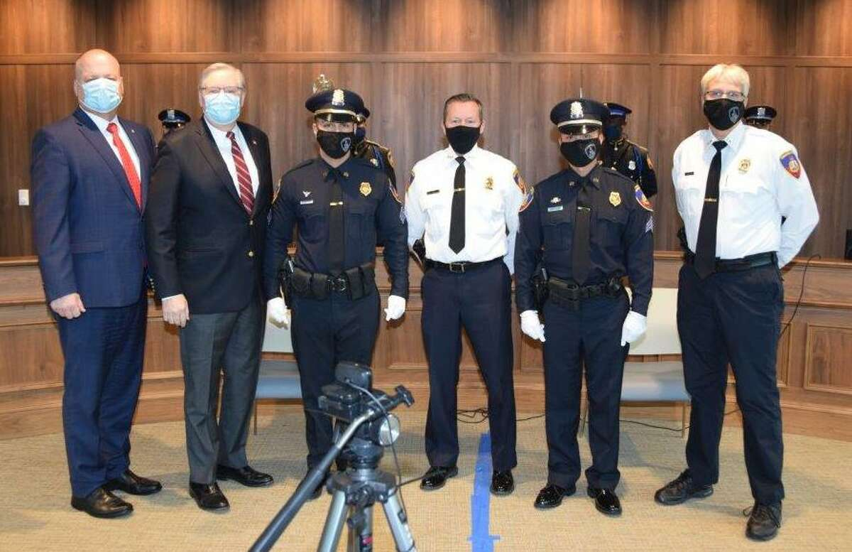 From left, Public Safety Director Ted Jankowski, Mayor David Martin and new sergeant Christopher Felman-Merced, police Chief Tim Shaw, new sergeant Michael Nguyen and assistant police chief Tom Wuennemann at a promotion ceremony at Stamford police headquarters Dec. 14, 2020. A 15-year member of the department, Nguyen has served in the bomb squad for the past seven years.