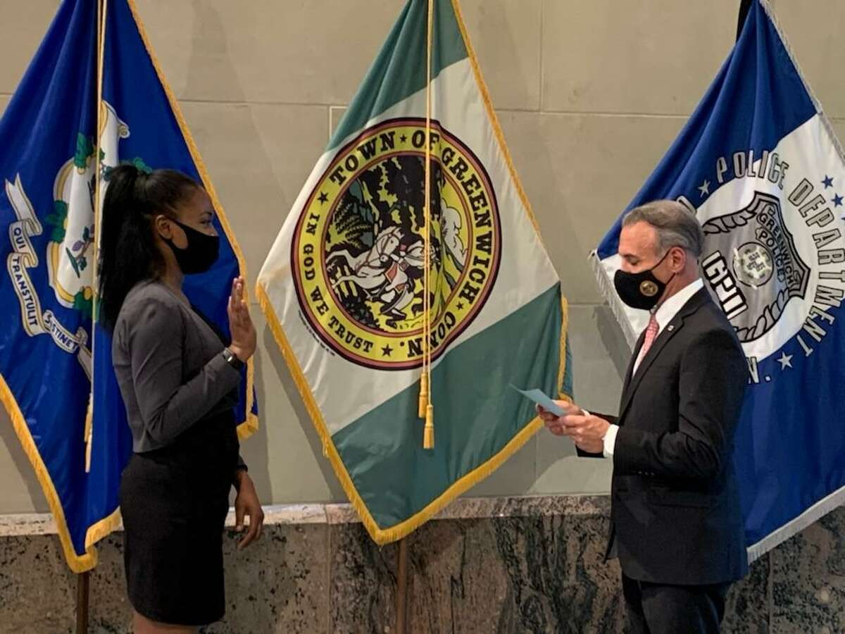 New Greenwich Police Officer Turiya Hamilton is sworn in recently in Greenwich, Conn., by First Selectman Fred Camillo.