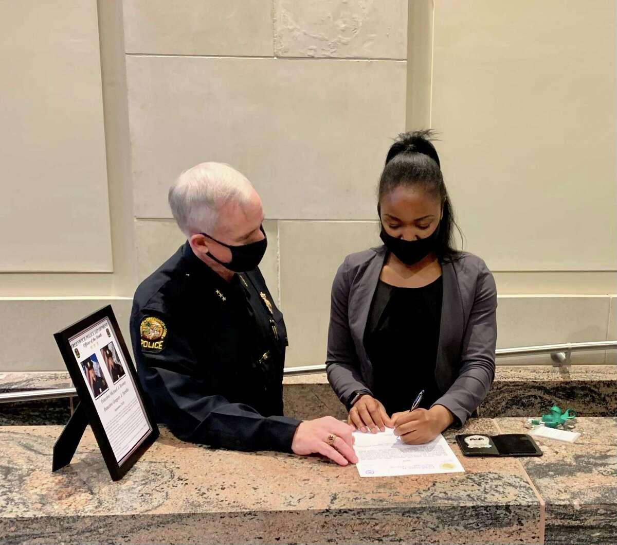 New Greenwich Police Officer Turiya Hamilton is sworn in recently in Greenwich, Conn.