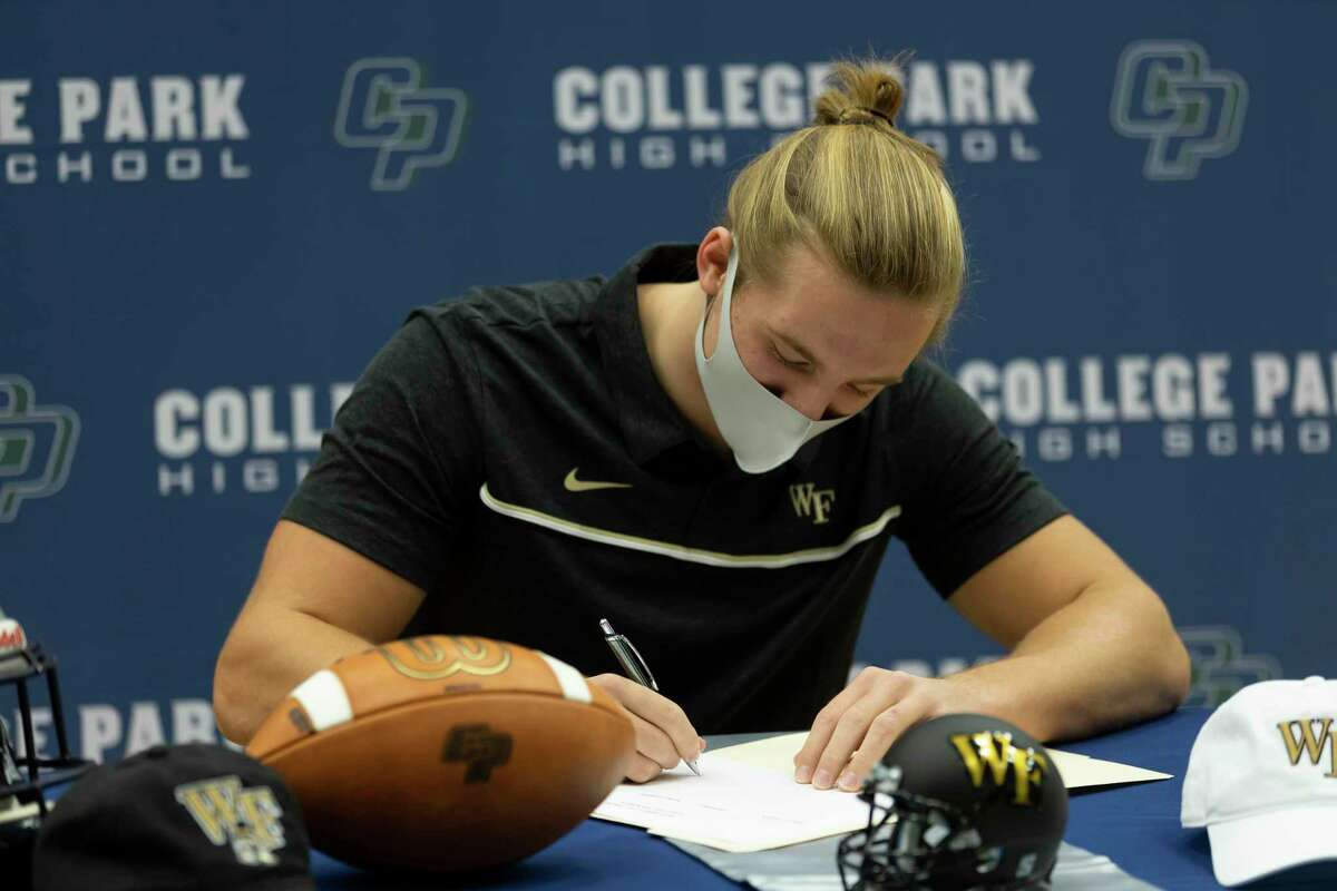 Dylan Hazen, who signed with Wake Forest's football team, signs during a National Signing Day ceremony at College Park High School, Wednesday, Dec. 16, 2020, in The Woodlands.
