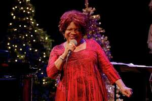 "Tina Fabrique signs in ""A Very Ella Christmas,"" streaming through Dec. 31."