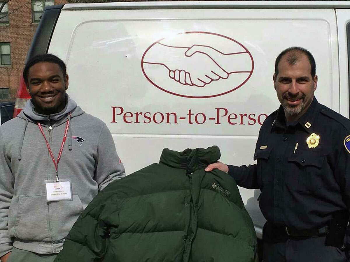 Stamford police Capt. Tom Barcello holds a winter coat that was donated by officers during a coat drive in 2019.