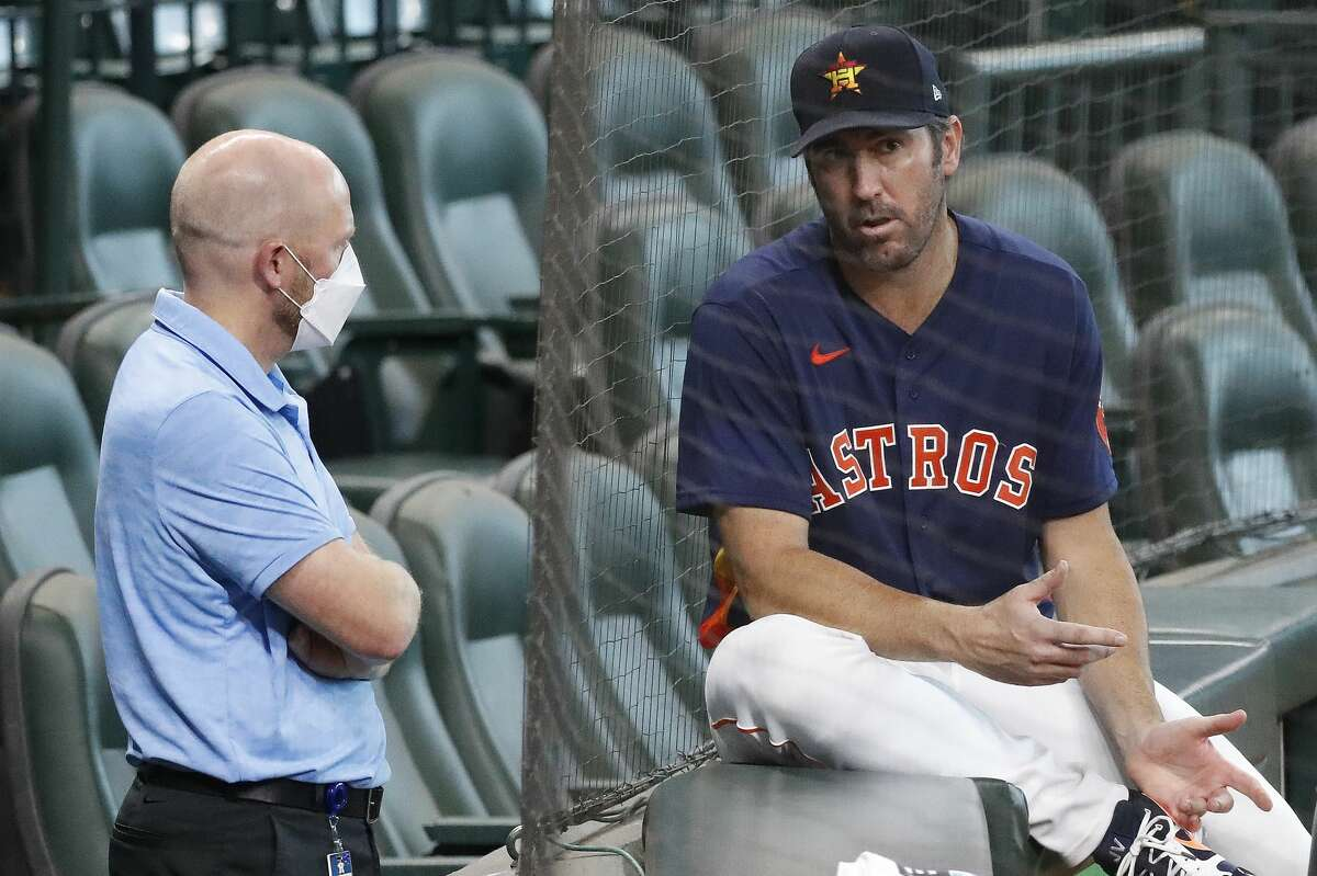 Justin Verlander, right, has expressed his intention to pitch in 2021 to Astros general manager James Click. Verlander underwent Tommy John surgery, which usually has a recovery timetable of 12 to 14 months, in September.