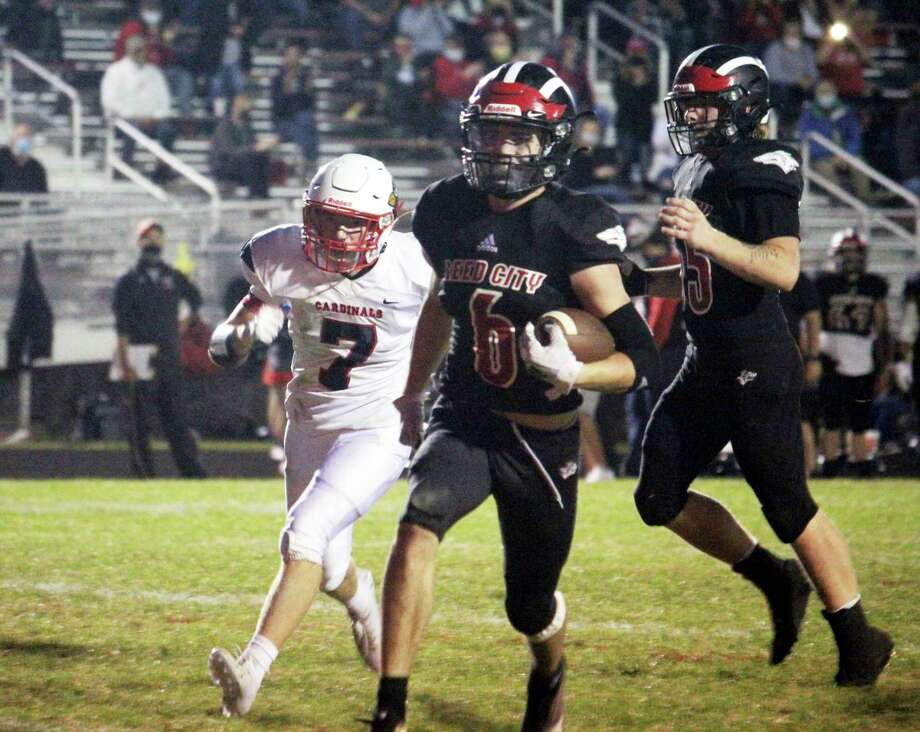 Reed City's Landen Tomaski runs past a defender during a game against Big Rapids earlier this season. (Pioneer file photo)