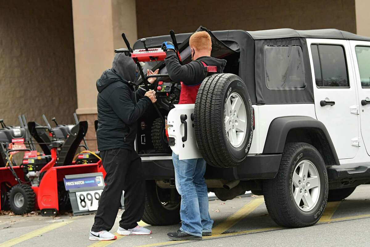 A customer gets help from an employee loading a snowblower into his car after his purchase at Lowe's on Monday, Dec. 16, 2020 in Colonie, N.Y. A nor'easter packing heavy snow is expected in the Capital Region later today. (Lori Van Buren/Times Union)