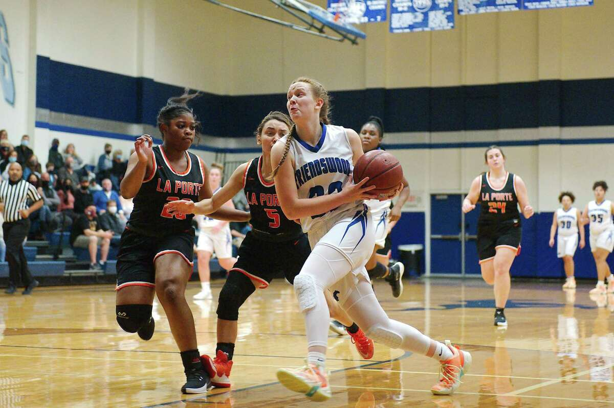 Friendswood's Ashlyn Ryall (23) drives to the basket against La Porte Tuesday, Dec. 15 at Friendswood High School.