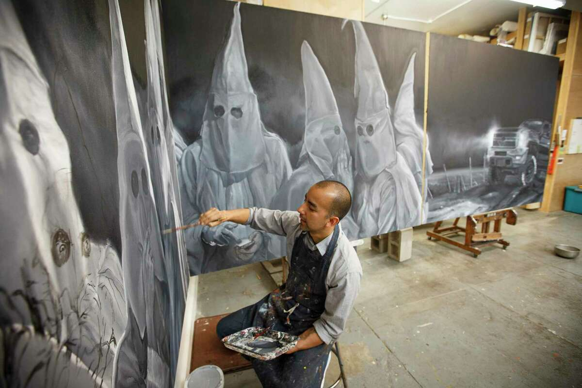 Vincent Valdez works on an eight-panel painting of a modern-day Ku Klux Klan gathering, in his studio in San Antonio in 2016.