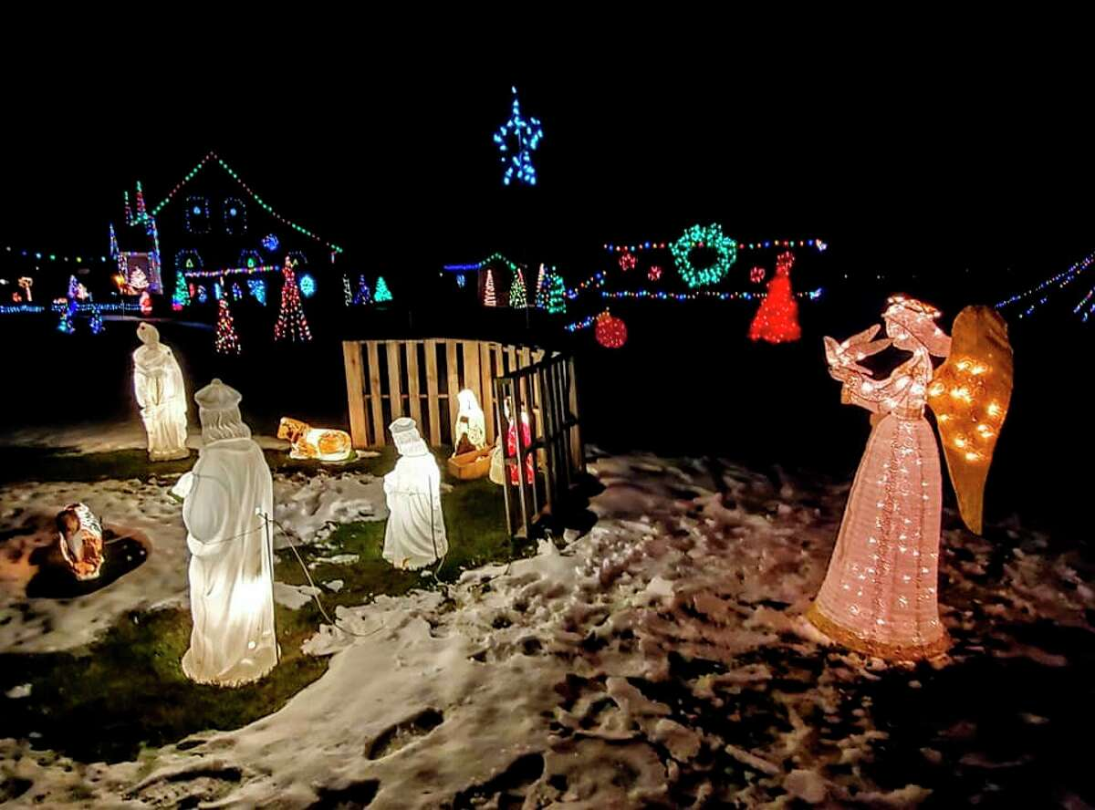 Bernie and Kelley Champagne, of Elkton, have been decorating their yard for Christmas since they were married 22 years ago, a display with now boasts over a mile of Christmas lights. (Courtesy Photo)
