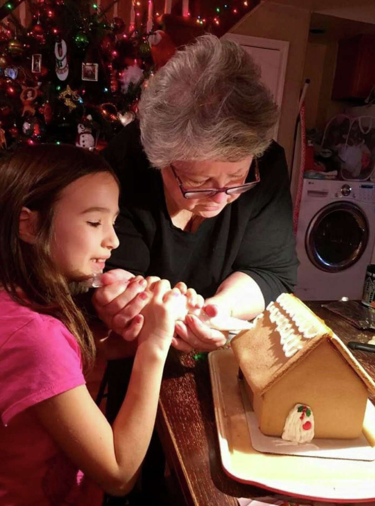 Jill Owens Zinzi teaches her granddaughter, Sofia, piping skills for icing a gingerbread roof. Sofia was 7 at the time. Zinzi, who started the Kent Gingerbread Festival, says Sofia is a third-generation gingerbread fan, along with her three grandsons. The Kent Gingerbread Festival, one of the largest in Connecticut, is in its 9th year and runs through December.