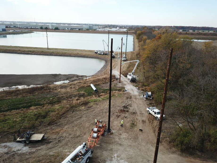 Crews working on behalf of Ameren Illinois are setting approximately 100 power poles and power lines from the company's Wanda Substation to the commerce center. Photo: Courtesy Of Ameren Illinois