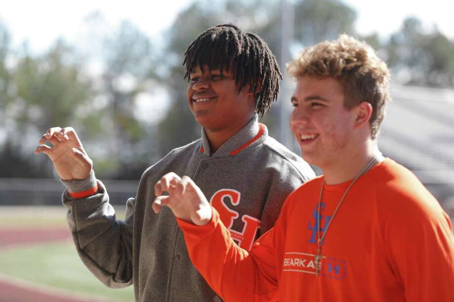 Marcus Collins poses for a photo beside Brady Dygert before a signing ceremony at Magnolia West High School, Wednesday, Dec. 16, 2020, in Magnolia. Collins signed to play football for Sam Houston State University. Photo: Jason Fochtman, Houston Chronicle / Staff Photographer / 2020 © Houston Chronicle