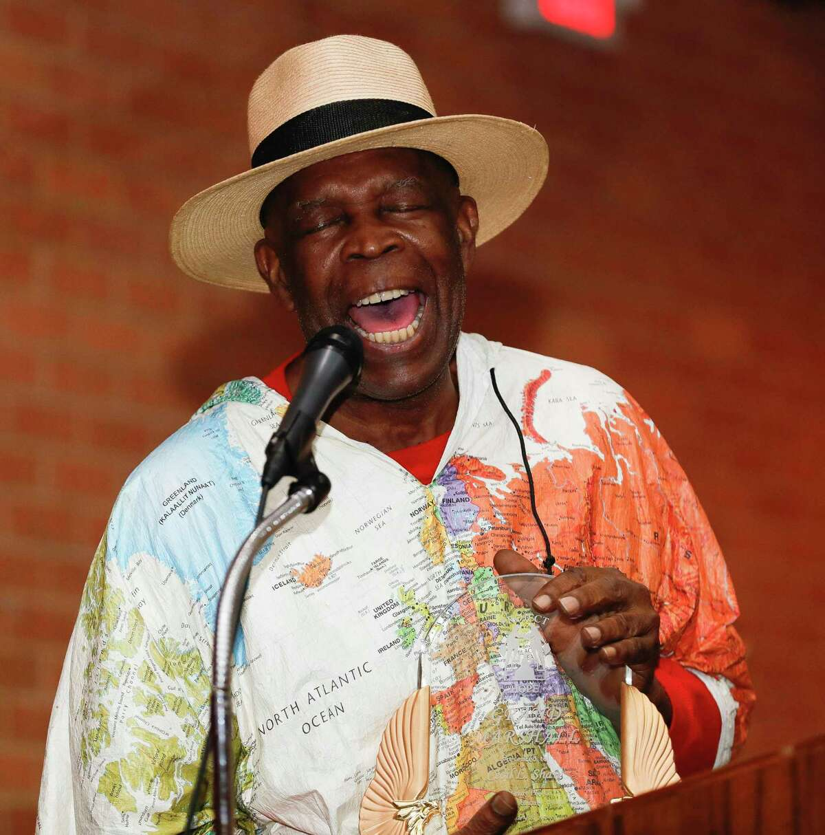 Cecil L. Shaw, Jr., who served as grand marshal of the annual Leon Tolbert Annual Black History Month Parade, sings at Booker T. Washington Junior High School, Saturday, Feb. 8, 2020, in Conroe.