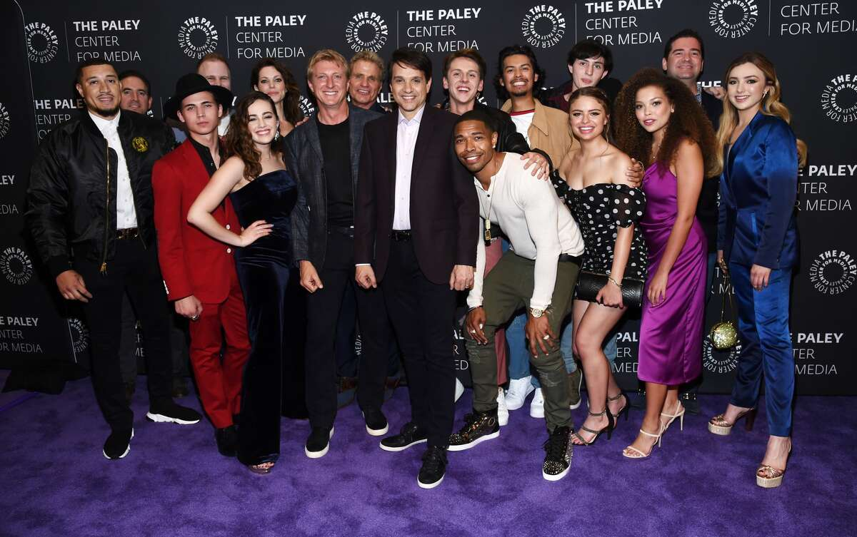 """The cast of """"Cobra Kai"""" attends the premiere screening and conversation of YouTube Original's """"Cobra Kai"""" Season 2 at The Paley Center for Media on April 22, 2019 in Beverly Hills, California. William Zabka, who played Johhny in the original movies, also stars in the remake. Santopietro said he enjoys hearing stories from the original cast, such as one that Macchio tells about how he caught a fly with chopsticks in the film. """"Everyone on the show is really great. It's a really fun community to be around,"""" he said."""