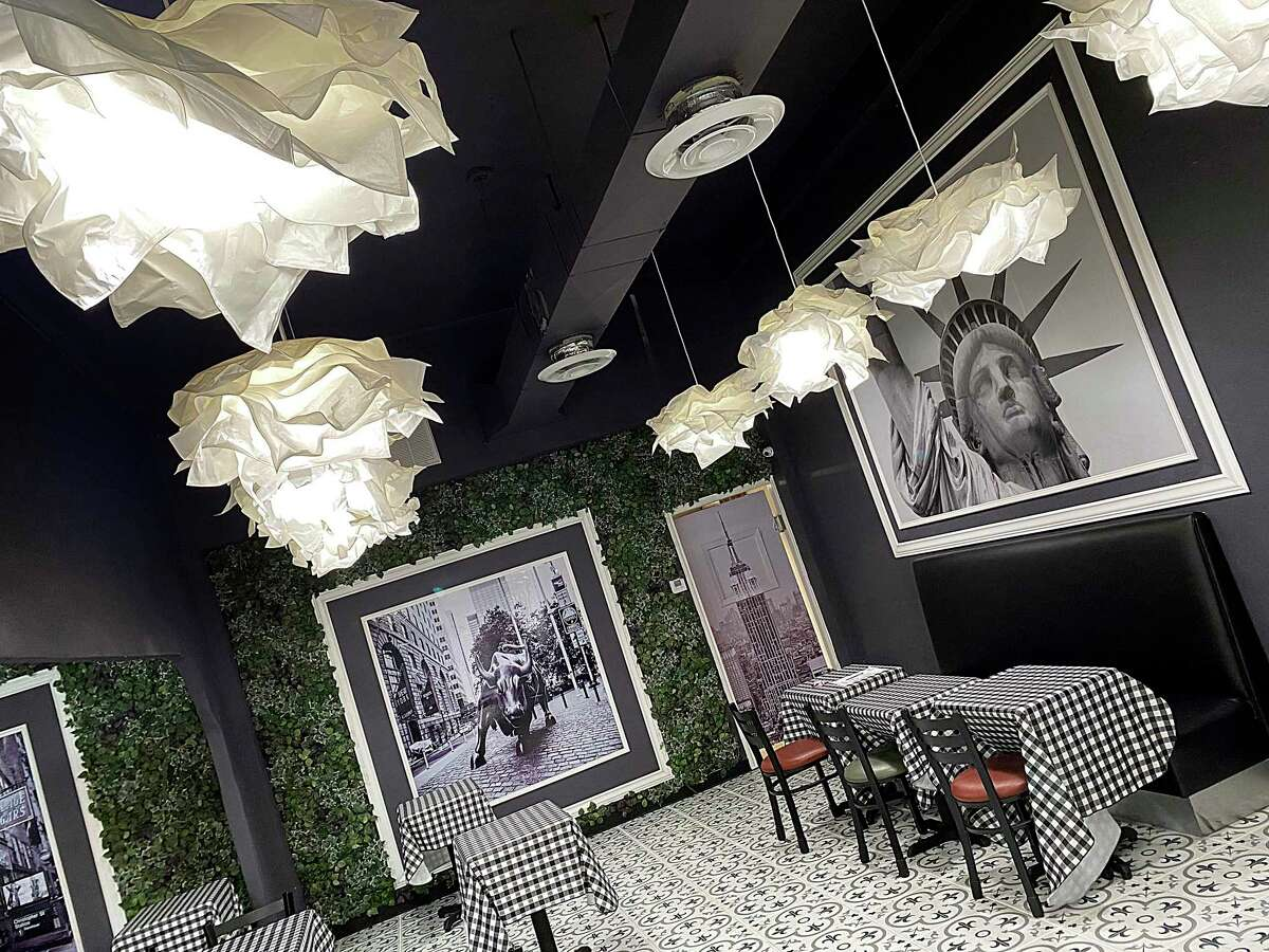 Owner Niece Wilson decorated the dining room with tile, New York prints and IKEA light fixtures at Goodfellas Famous NY Pizza on Jefferson Street in downtown San Antonio.