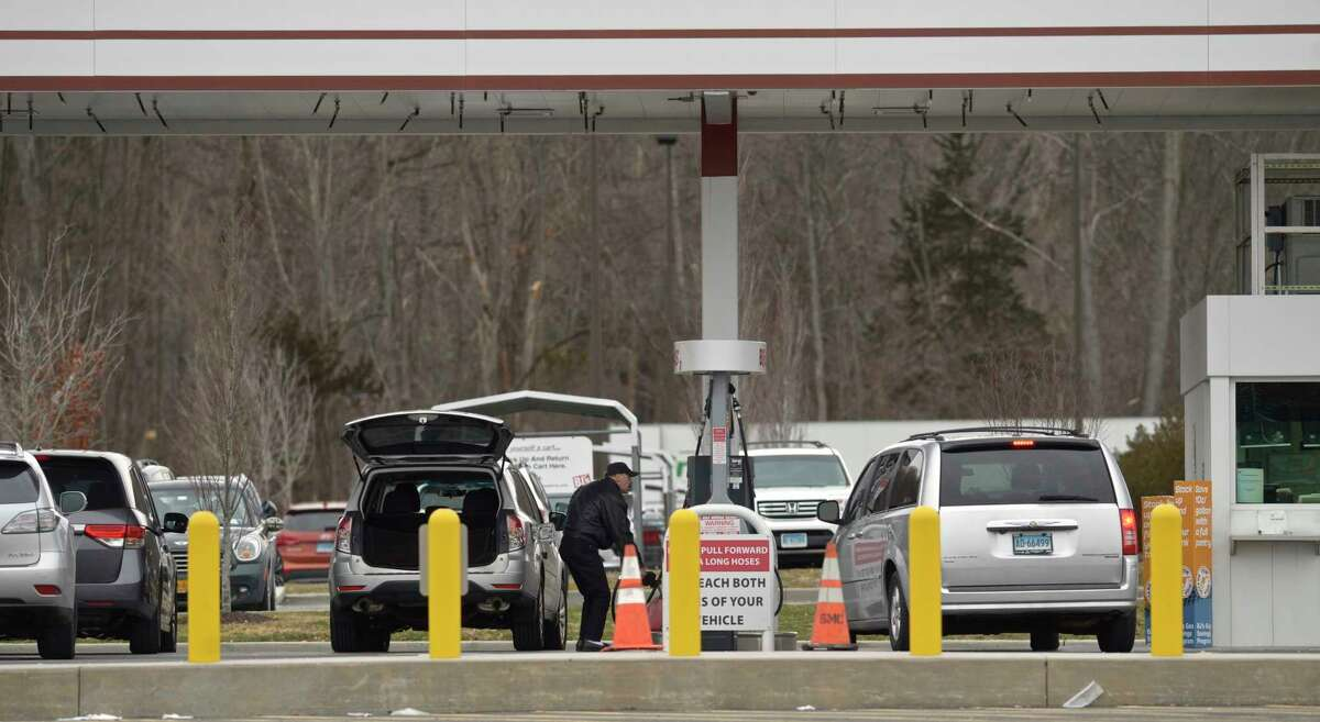 People fill up their cars at BJ's Gas as they prepare for a nor'easter that is forecast to bring heavy snow Wednesday into Thursday. Wednesday, December 16, 2020, in Danbury, Conn.