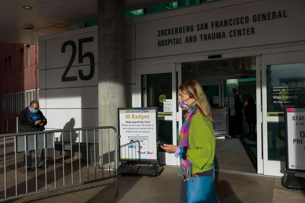 People walk through San Francisco General Hospital on Tuesday, Dec. 15, 2020 in San Francisco, California.The availability of Bay Area intensive care unit beds dropped to 12.9% on Tuesday, triggering California's regional stay-at-home order.