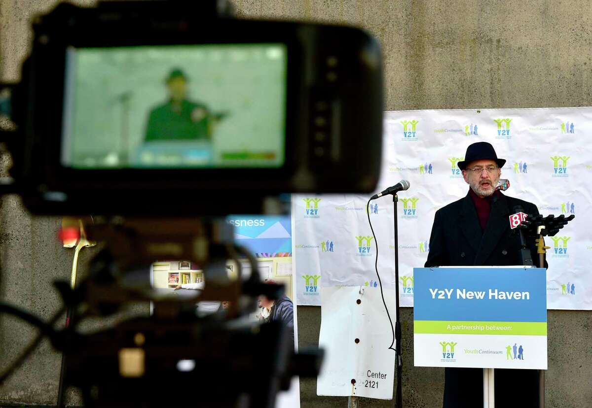 Paul Kosowsky, CEO of Youth Continuum, speaks during a ground-breaking ceremony Dec. 15 for Y2Y New Haven, a $4.5 million project to transform a Grand Avenue counseling center into a national model for helping homeless youth find urgently needed housing and services.