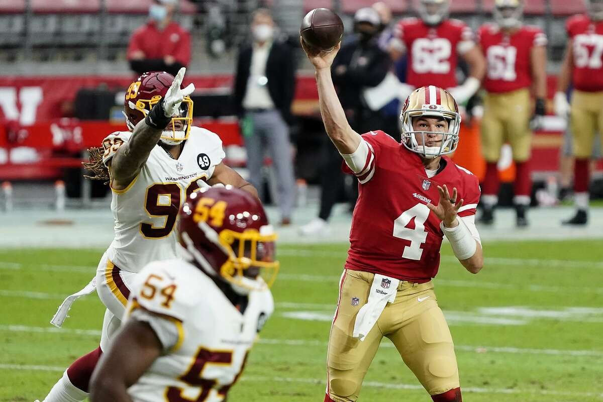 San Francisco 49ers quarterback Nick Mullens (4) throws against the Washington Football Team during the first half of an NFL football game, Sunday, Dec. 13, 2020, in Glendale, Ariz. (AP Photo/Rick Scuteri)