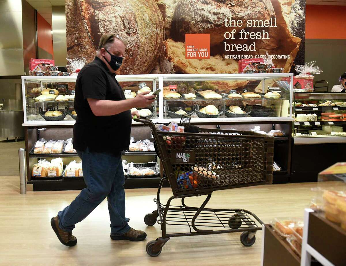 Instacart shopper Roger Allan of Hadley is seen shopping for a customer in Market 32 grocery store on Friday, Dec. 11, 2020 in Wilton, N.Y. (Lori Van Buren/Times Union)