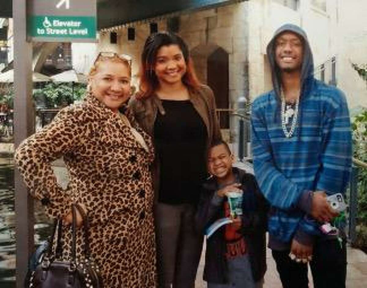 Syble Davis (left) and her daughter Chariti, her youngest son Chance, and Chase.