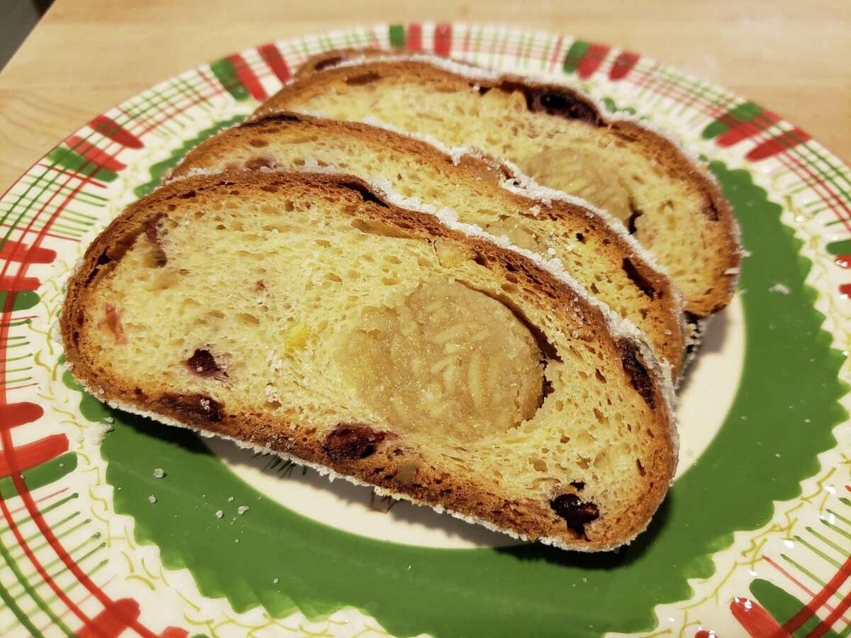 SoNo's Dresden style Stollen has a generous ribbon of marzipan wrapped in a yeast dough studded with candied orange and dried cranberries.