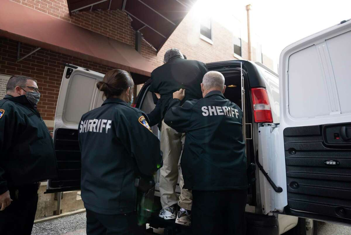 Manuel La Rosa-Lopez is escorting to the back of a Montgomery County transportation van after his sentencing in downtown Conroe, Wednesday, Dec. 16, 2020. La Rosa-Lopez pleaded guilty last month to several counts of indecency with a child accepting a 10 year sentence.
