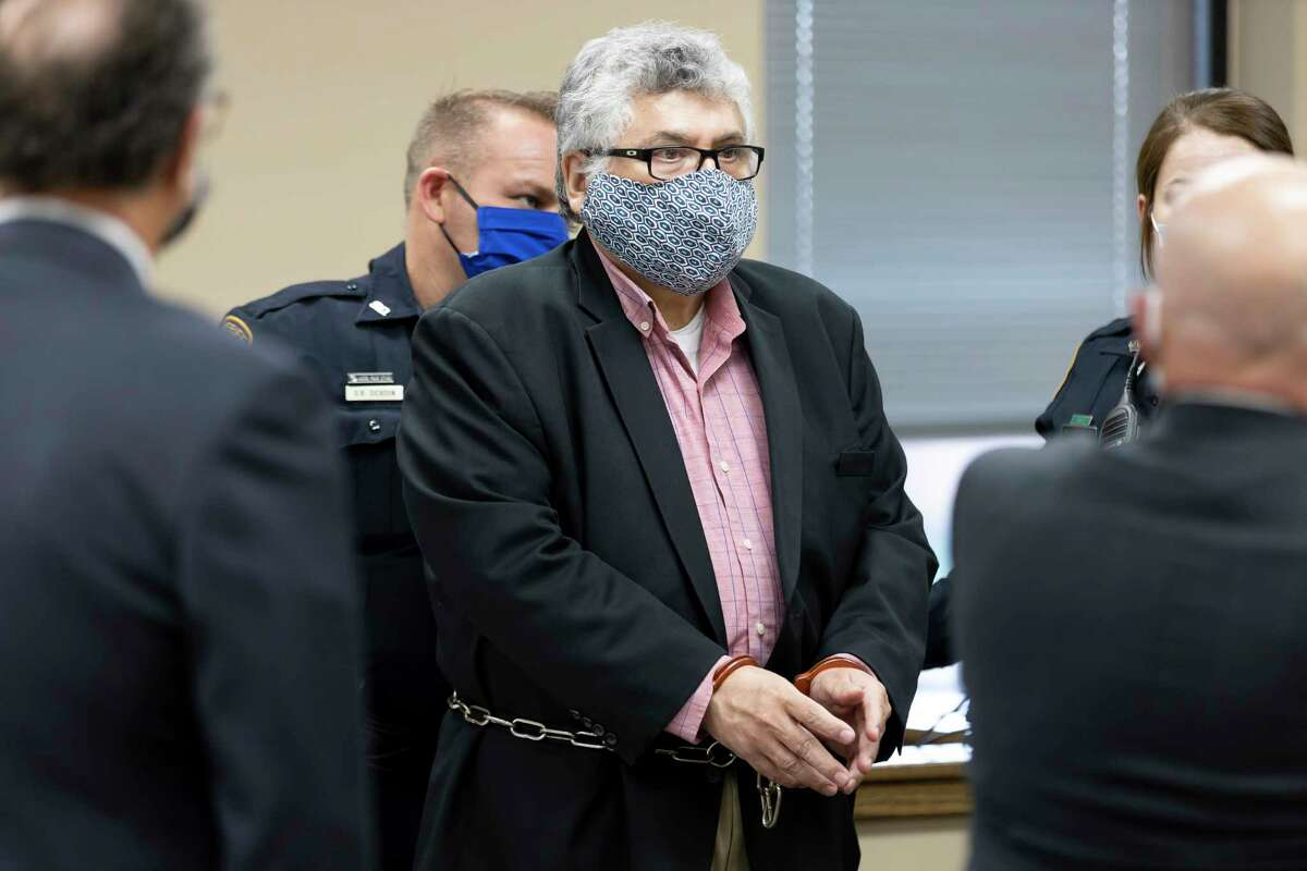 Manuel La Rosa-Lopez is escorting out of courtroom after his sentencing in downtown Conroe, Wednesday, Dec. 16, 2020. La Rosa-Lopez pleaded guilty last month to several counts of indecency with a child accepting a 10 year sentence.