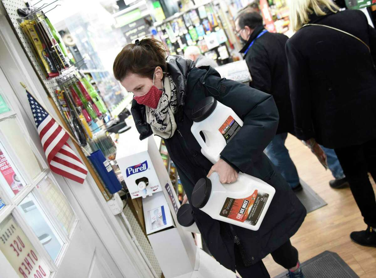 Greenwich resident Sarah Wheeler stocks up on ice melt at Feinsod Ace Hardware in Old Greenwich, Conn. Wednesday, Dec. 16, 2020. Folks stocked up on shovels, ice melt, and groceries in anticipation of the winter storm expected to dump more than a foot of snow starting Wednesday night.