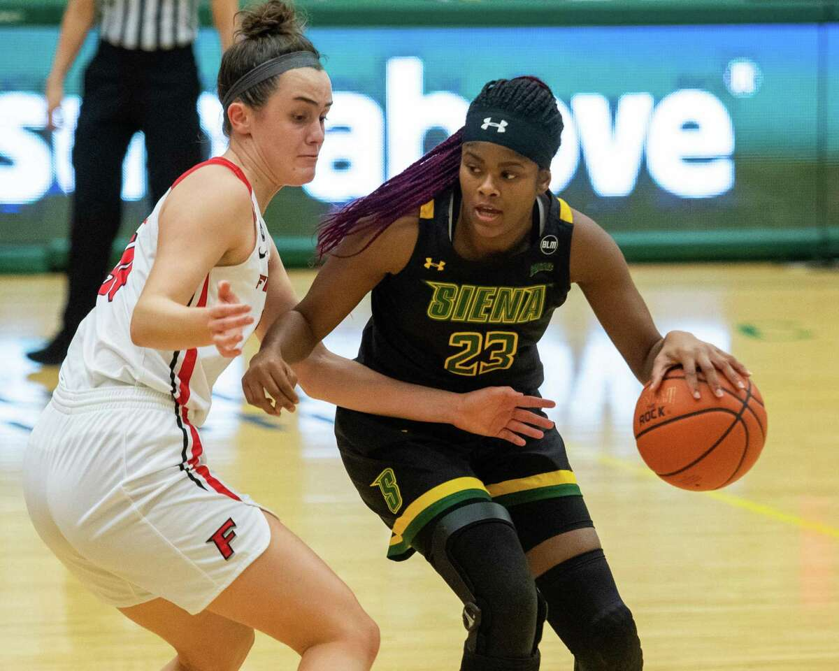 Fairfield's Sam Lewis, left, defends Siena's Isis Young on Saturday. Lewis scored a single-game school-record 39 points and a MAAC-record 11 3-point shots in the game.