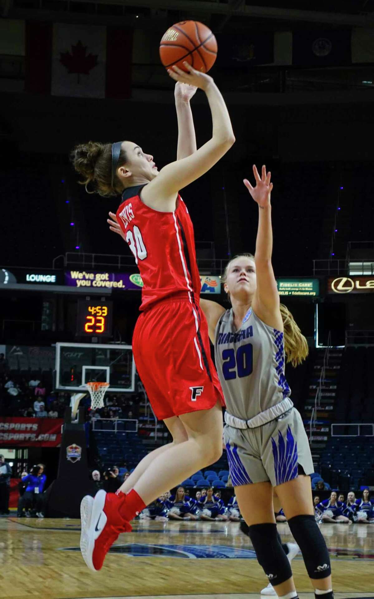 Fairfield's Sam Lewis puts up a shot over Niagara's Ally Haar during a MAAC Tournament game in 2019.