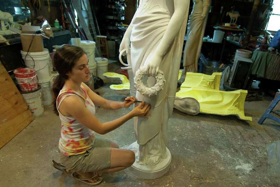 """Sculptor Emily Bedard works on """"Lady Liberty"""" in her studio. The statue is being created to sit atop the Soldiers and Sailors Monument in Seaside Park. It will be unveiled Sept. 10 at an evening benefit for Bridgeport's City Lights Gallery in the showrooms at Dragone Classic Motor Cars on Main Street, Bridgeport. Photo: CONTRIBUTED PHOTO"""
