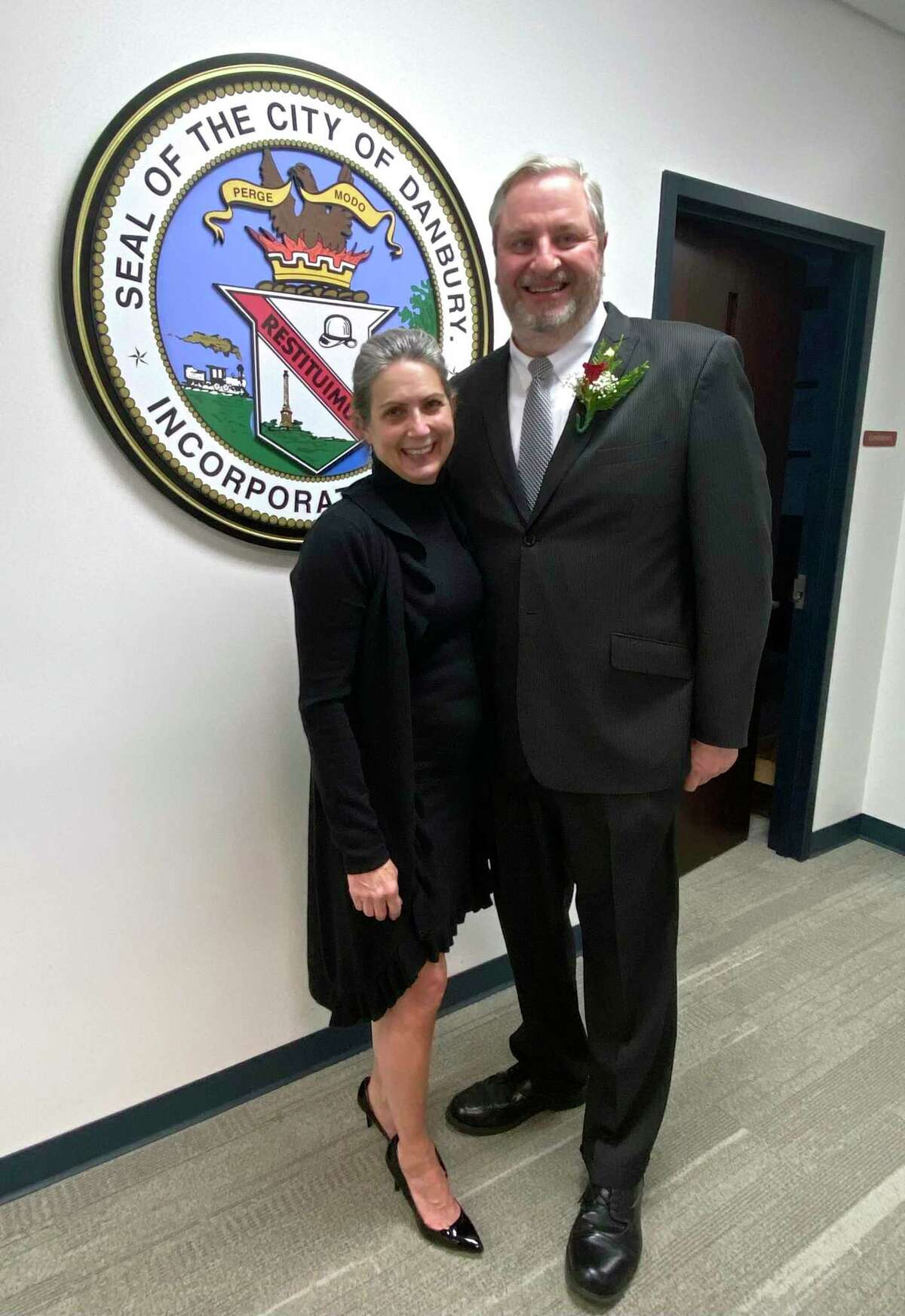 Joseph M. Cavo, right, was sworn in as Mayor of the City of Danbury, with his wife Liz Cavo. Wednesday, December 16, 2020, in Danbury, Conn.