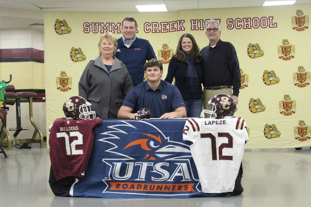 Luke Lapeze signs to play football at UTSA and is joined by his family.