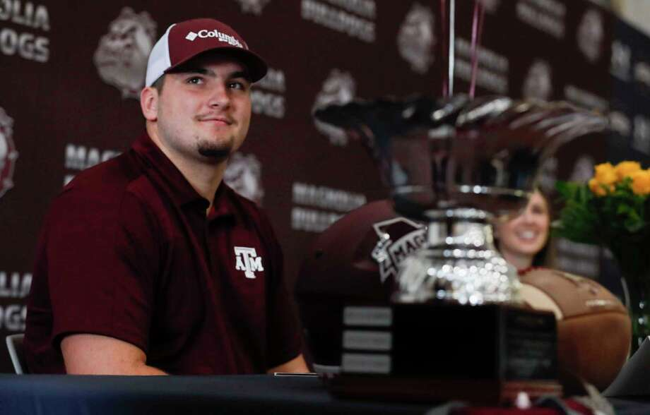 Matthew Wykoff signed to play football for Texas A&M during a signing ceremony at Magnolia High School, Wednesday, Dec. 16, 2020, in Magnolia. Photo: Jason Fochtman, Houston Chronicle / Staff Photographer / 2020 © Houston Chronicle