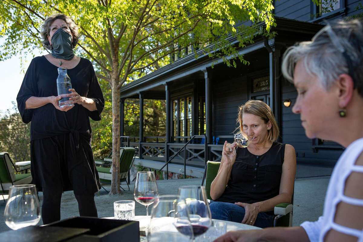 Kim Wertz hosts a wine tasting for Jen Beloz and Kim Westerman at the Faust Haus in St. Helena, California.